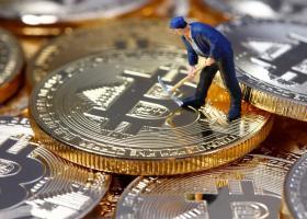Τα 5.000 δολάρια άγγιξε η τιμή του bitcoin ύστερα από άλμα 20% - Κεντρική Εικόνα