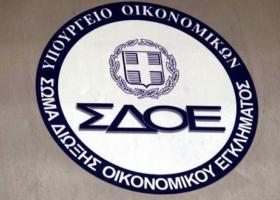 Εφοδος ΣΔΟΕ σε σπίτια και γραφεία στην Ελλάδα για το σκάνδαλο της FIFA - Κεντρική Εικόνα