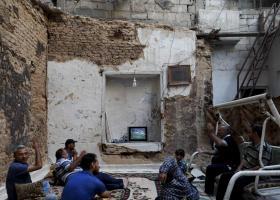 Παρακολουθώντας τον τελικό αγώνα του Παγκοσμίου Κυπέλλου στη Συρία - Κεντρική Εικόνα