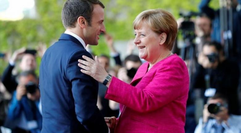 Ο Μακρόν θα στήριζε την Μέρκελ αν εκείνη διεκδικούσε την προεδρία της Κομισιόν - Κεντρική Εικόνα
